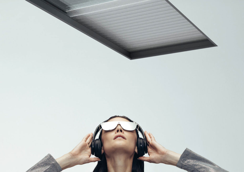 Woman-looking-up-at-blind